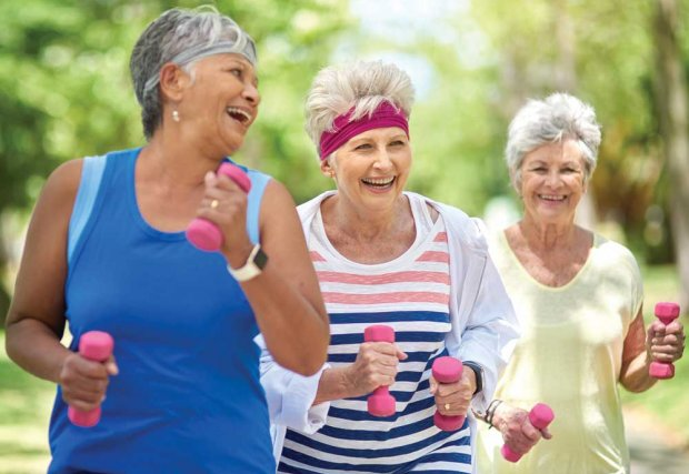 Group of older women exercising outdoors